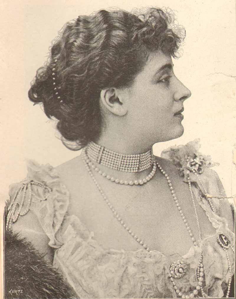 actress with pearls and waved hair